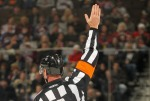 Hockey Referee Penalty Signal. Image Credit: Doug Pensinger/Getty Images
